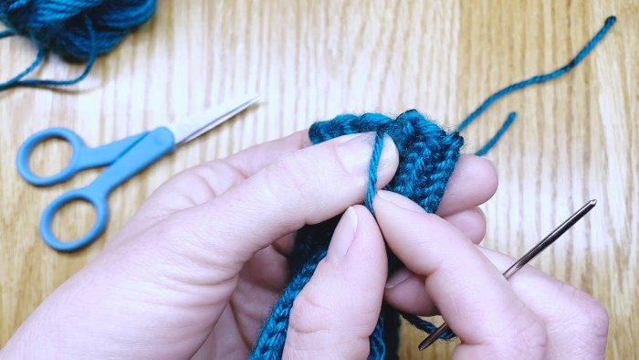 Step 2: Weave in the cast-on tail of mittens - a knitting lesson from Liz Chandler @PurlsAndPixels.