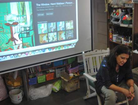 Purnima Sampat talking and showing a slide show to the kids about French Artist Henri Matisse