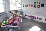 Table of drink and nibbles in the end studio at the open evening event