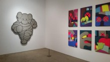 CHUM (left), 2012, KAWS, Ac UPS AND DOWNS (2013) KAWSrylic on canvas over panel.