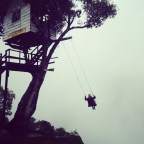 swinging off the edge of the world in Banos, Ecuador