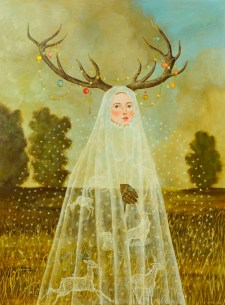 Portrait of a veiled woman that wears deer horns surrounded by a natural landscape.