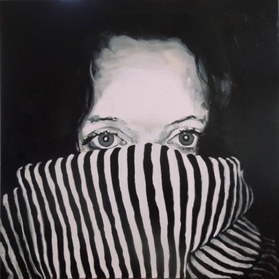 Portrait of a woman with half face covered by a striped texture clothing.