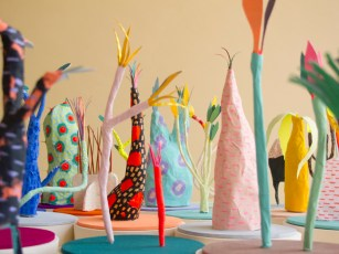 Still life photo of a group of abstract organic sculptures made of paper.