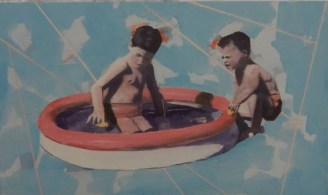 Portrait of two little boys inside a inflatable pool.