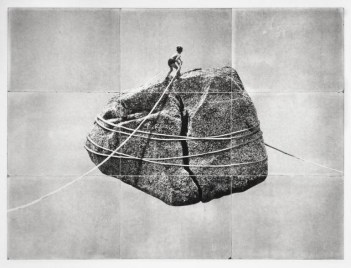 Boy hiking a giant floating rock.