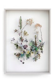 Still life photo of a framed 3D collage artworks of flowers.