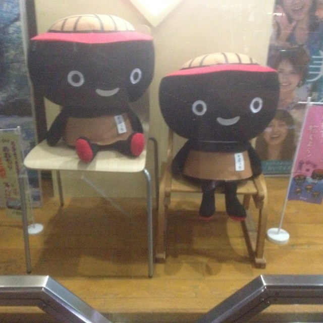 Cut little dolls in a window display, Tuesday, March 22, 2016