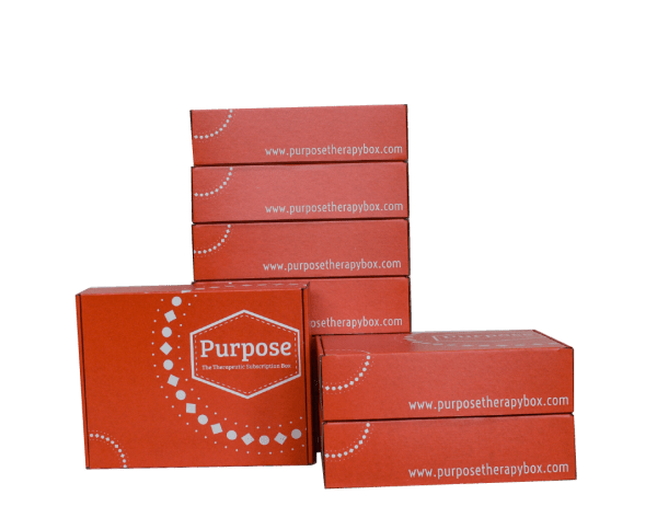 Bright orange Purpose box with white lettering