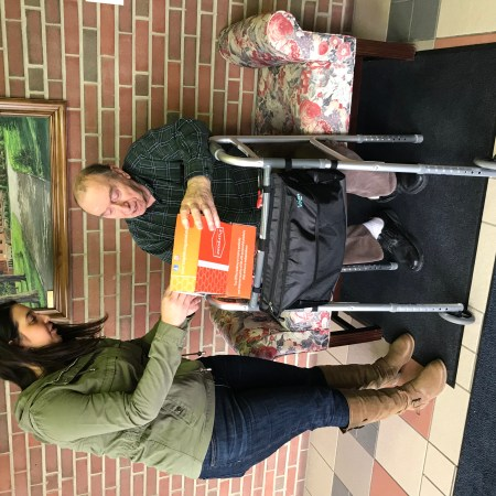 Purpose Founder Ali Izzo hand delivering orange Purpose Box to grandpa