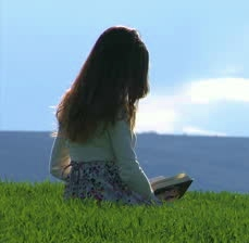 stock-footage-young-woman-walking-on-spring-grass
