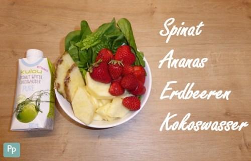 Zutaten für einen grünen Smoothie mit Erdbeeren und Ananas