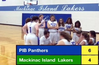 """Put-in-bay Panthers had a very successful Great Lakes Islands Tournament! The girls repeated as the champions with three thrilling games.  The Panther Girls started the tournament versus Beaver Island and had a tough back-and-forth game.  With less than a minute to go the Panthers found themselves down three; during a timeout coach Schuffenecker drew up a play for senior Hannah Lentz and she nailed a three pointer to tie the game.  After a change of possession, Kate Byrnes got a loose ball and raced down and hit a buzzer-beating shot to secure the victory.   It was the boys' turn against Beaver Island next.  Beaver Island proved too powerful for the Panthers and the boys were defeated.  The girls then took on the Washington Island Bucks from Wisconsin.  The girls took the lead early and did not look back.  They finished the day 2-0 and in control of their destiny.  The boys played the Bucks next and fell in defeat, despite some hot shooting from the three-point line.  The boys were 0-2 and still had the rivalry game versus Mackinac Island.   Later that night the teams enjoyed an evening of games together. The Panthers woke up Saturday with just one game each.  Both teams would play their rival, Mackinac Island.  The Rock Trophies were on the line.  The trophies were created by the late Voice of the Panthers, Patrick Myers.  Both teams wanted to maintain the trophies.   The girls also had the tournament championship to play for. The boys would play first.  Earlier in the day the Islanders won the boys tournament with an undefeated record.  Although not being able to win the championship, the boys were determined to finish strong in the final contest.  Jacob king led the Panthers to an early lead.  He scored all 19 first-half points and the Panthers led at the break, 19-16.  The Panthers held a comfortable lead throughout the second half.  The pesky Lakers of Mackinac never gave up, but when the clock hit zero the Panther boys were victorious and """"The Rock"""" stays on S"""
