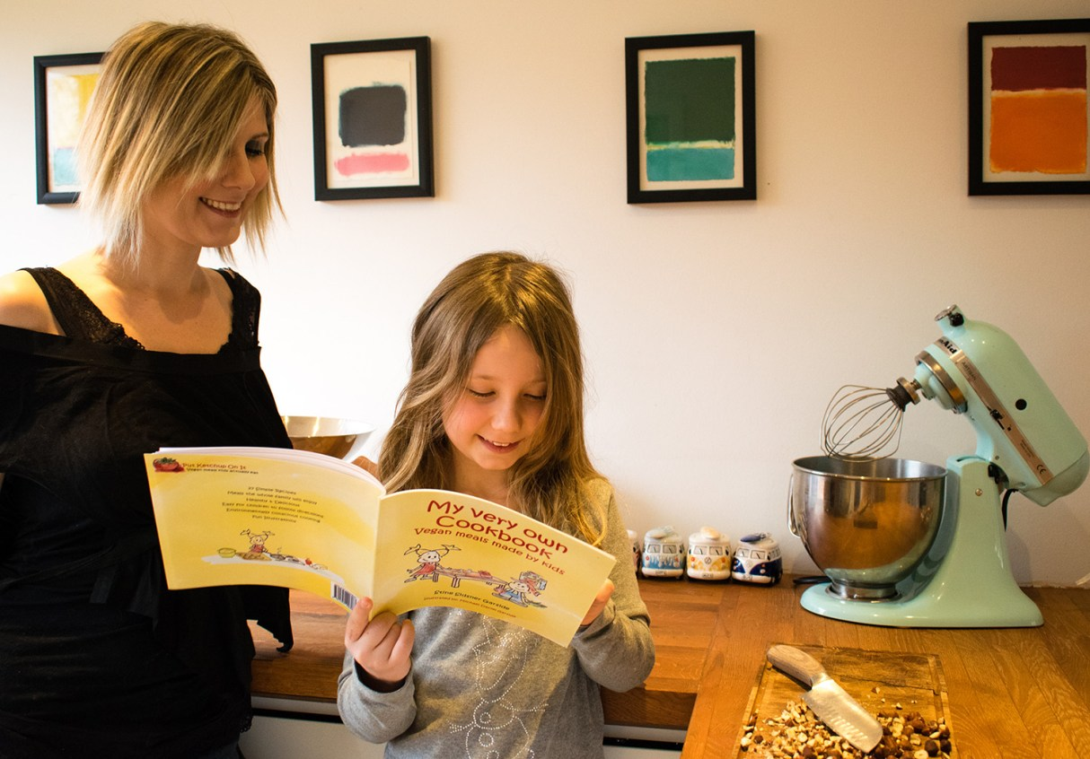 Image showing Stine and Nyah using My Very Own Cookbook