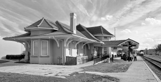 Photo of palatka Train Station with passenger train arriving, black & white