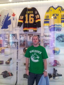 Rob in front of some classic jerseys in the arenas museum area
