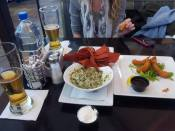 Enjoying a beer and appetizers before getting on the plane