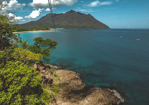 Zipline aerial view of the sea and beach