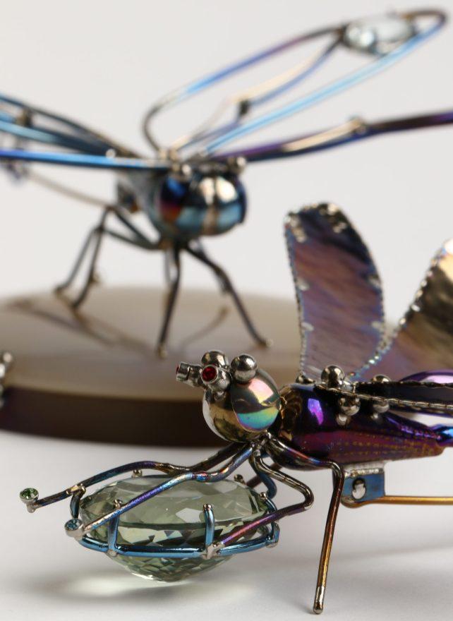 "Māris Šustiņš, brooch - titanium, agate. Brooch ""Dragonfly"" - titanium, gold 18k, aquamarine. Brooch - titanium, grenades, amethysts."