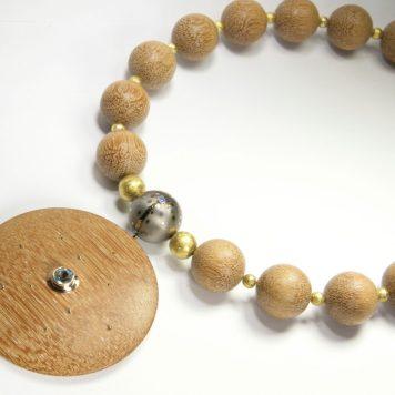 Māris Šustiņš, necklace - silver 925, gold 585, titan, topas, IROKO wood