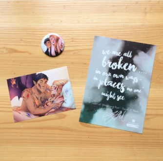 A signed quote card, and a mirror and sticker with illustrations of two scenes in ACOMAF.