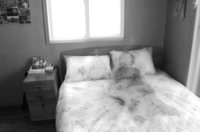 Poltergeist as an apparition on the bed