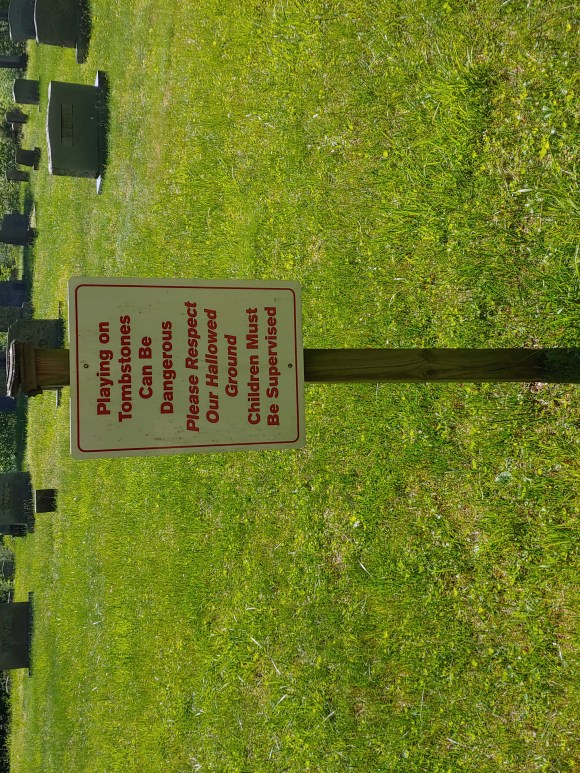 Sign in front of tombs at St. John's Episcopal Church