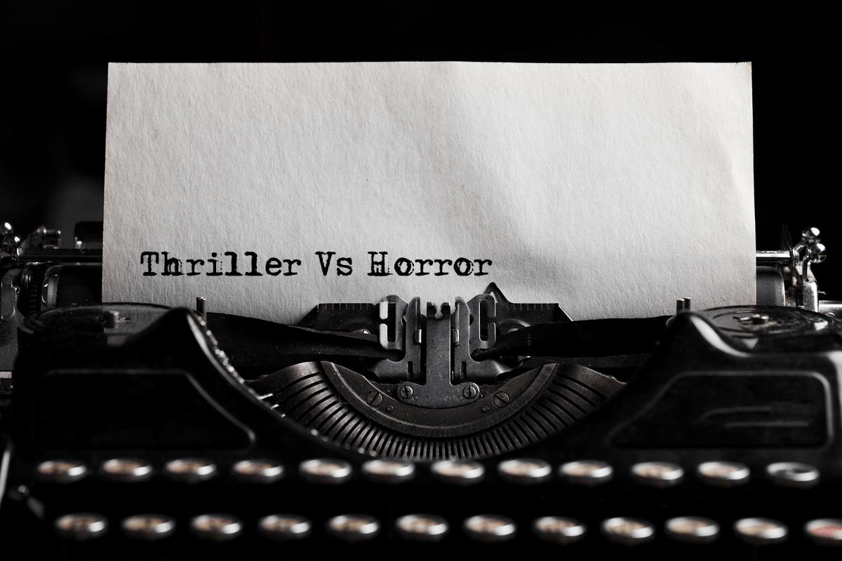 Thriller Vs Horror type writer on paper