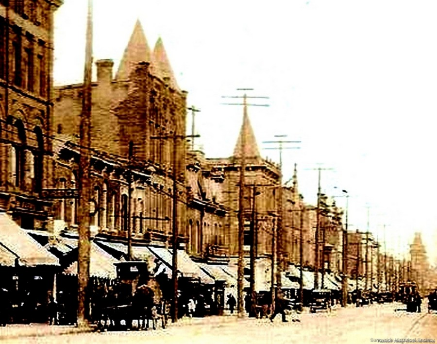 q 1408 1410 Queen St W 1910 photo. In 1889 F W Hutt operated a hwr store Furnishings Paints and Putty .1914 a grocer J N Carsar