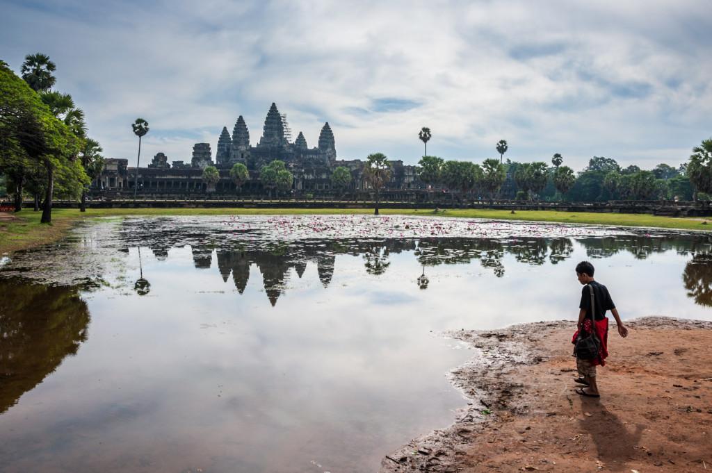 Boy near pond in Angkor Wat