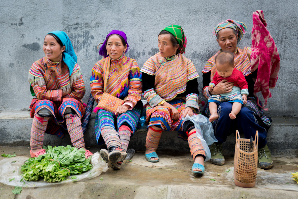 A small group of Flower Hmong women sit in the market in Bac Ha, outside Sapa, Vietnam.