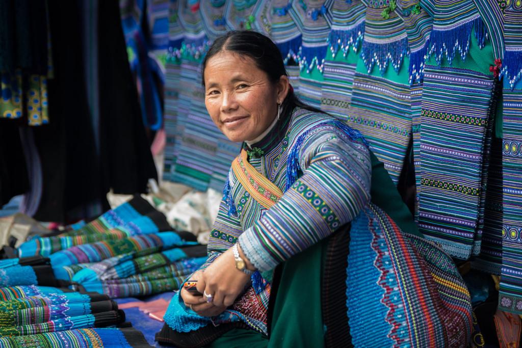 A Blue Hmong woman sells fabrics in the Bac Ha market outside Sapa, Vietnam.
