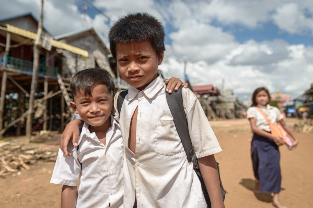 Young brothers on their way home from school, in Kompong Phluk village, outside Siem Reap, Cambodia.