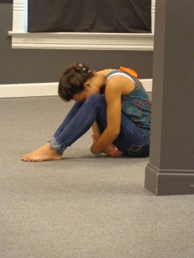 picture of a student praying alone