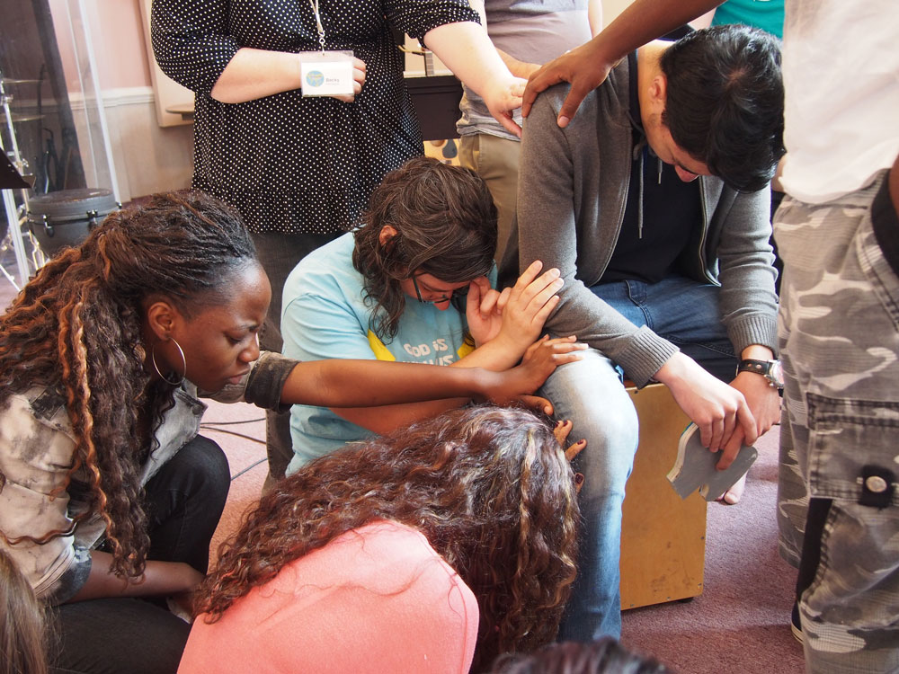 Students praying together