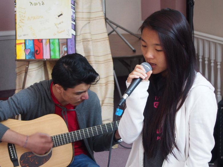 Two students sharing a song