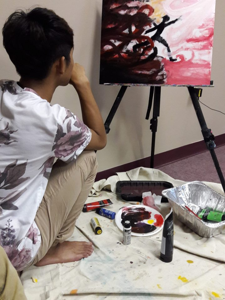 A student creating a painting