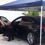 Oviedo, Florida Installing window film on a car in a driveway. Professional Window Tinting of Central FL LLC