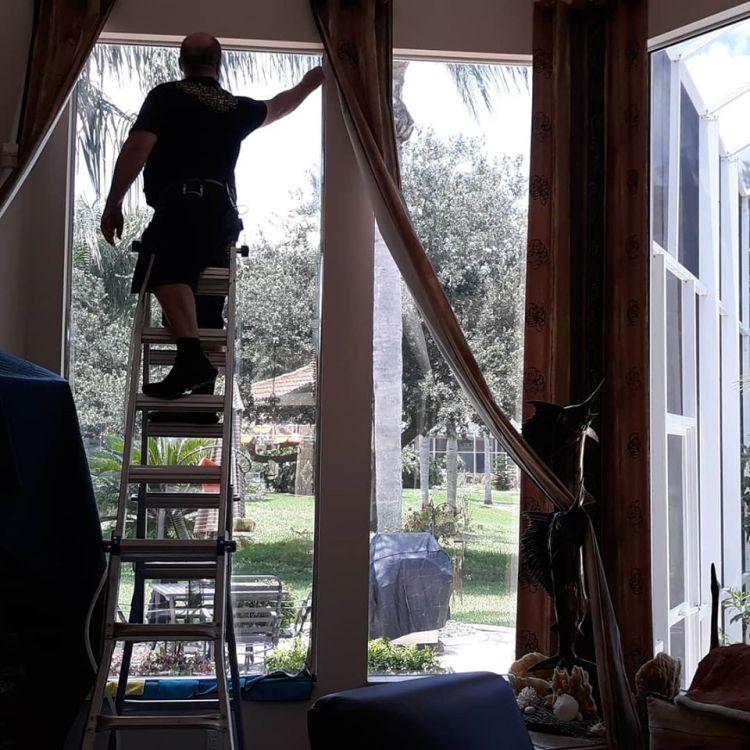 Installing window film on residential windows