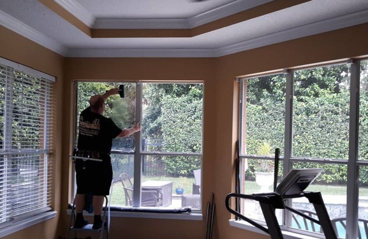Portfolio pictures Installing window film on residential glass.