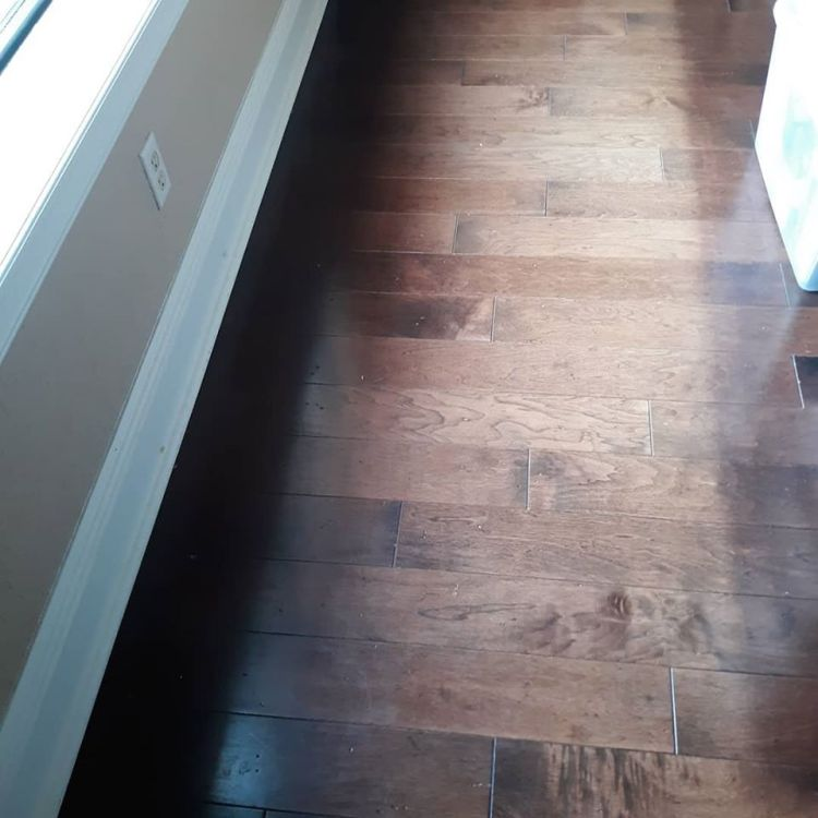 Residential Sun damaged wood floor at a Lake Mary home. Professional Window Tinting of Central FL LLC house