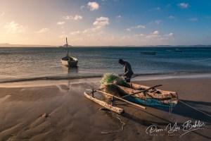 Antsiranana, Madagascar, October 13, 2016: A fisherman repairing his fishing net on the Ramena beach near Diego Suarez (Antsiranana)