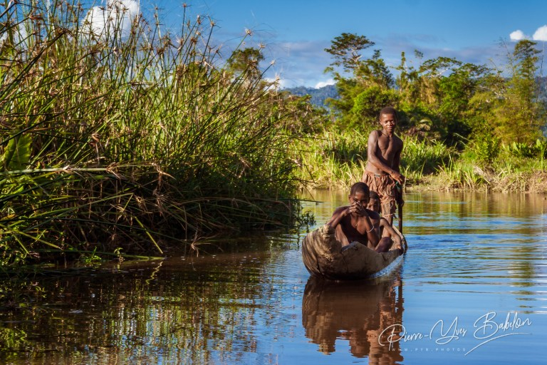 Malagasy people in a canoe