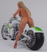 coco_austin_deleted_twitter_myspace_pics_Bike_red_sling