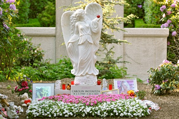 "Cora was buried in a pink coffin at Hamburg's Ohlsdorf Cemetery on 2 February 2011. In May 2011, however, cemetery officials demanded that her husband remove a four-feet tall marble angel and memorial photos that marked the grave, claiming the $15,000 installation was ""too sexy"".[13] They argued that the grave's markings were inappropriate and could be deemed ""offensive by other mourners visiting the cemetery,"" one of the largest in the world."