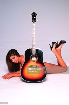 Jasmin St Claire nude behind guitar