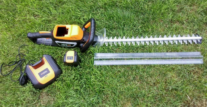 TackLife Cordless Hedge Trimmer full set Review - We tested this hegde trimmer over several weeks on different hedges including privet, laurel, leylandii as well as for trimming back trees.