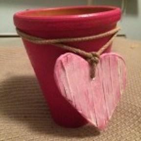 Rosa hjärta på kruka fram