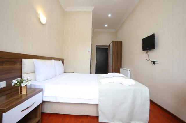 A bed or beds in a room at HOTEL ARISTOCRAT