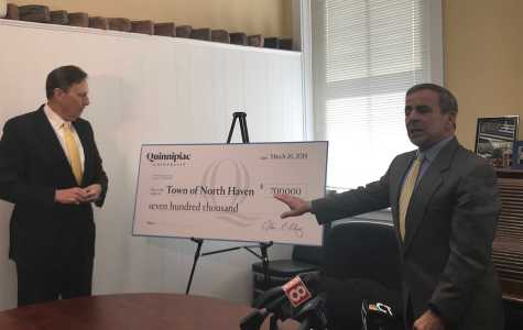 Quinnipiac presents North Haven with a check for $700,000